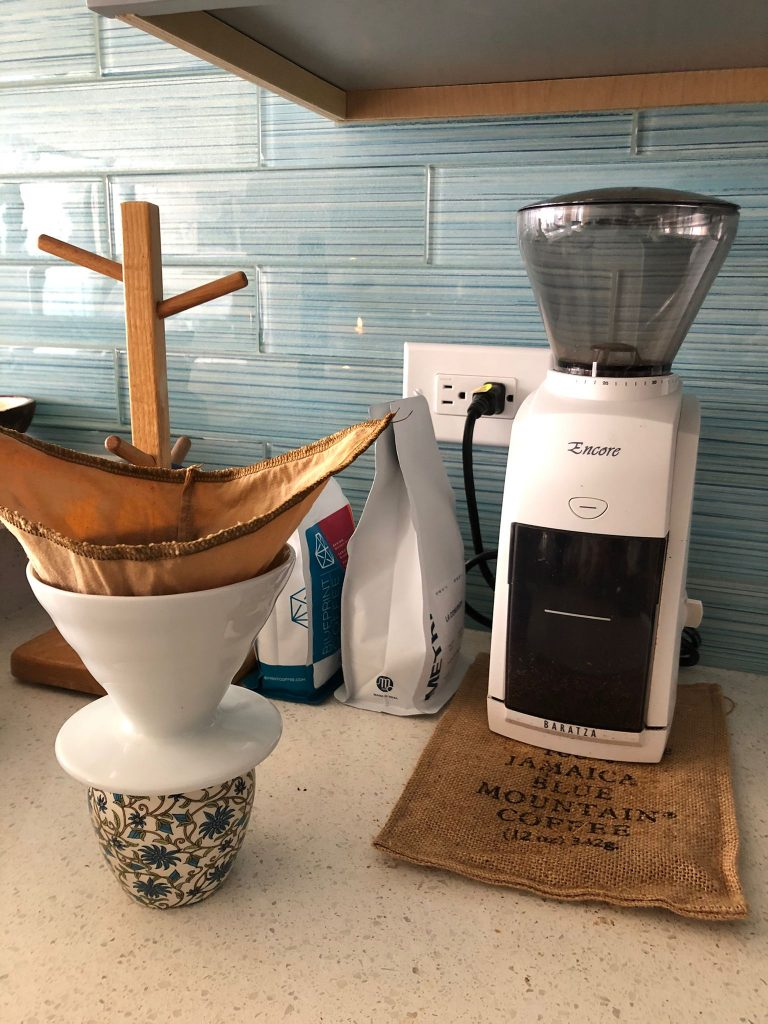 baratza encore next to a pour over funnel