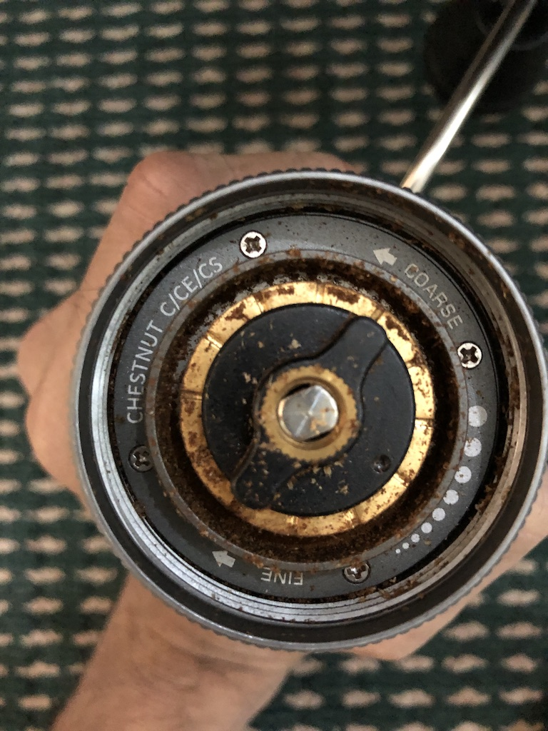 timemore c2 adjustment knob with coffee grounds stuck to it
